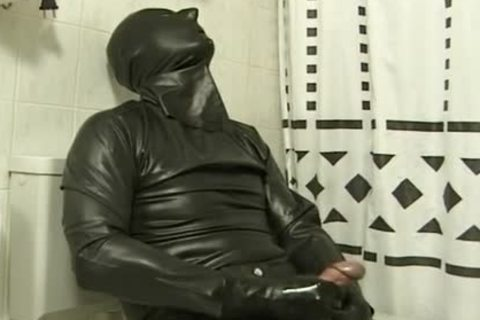 lad In darksome Latex Catsuit Jacks Off In baths