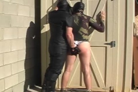 Masked males disrobe And dril Each Other outside