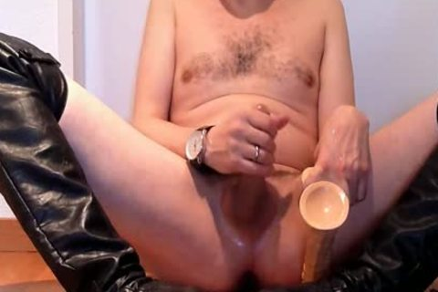 Jerking Wearing darksome Over-knee High-heels With fake ramrod And Cumming