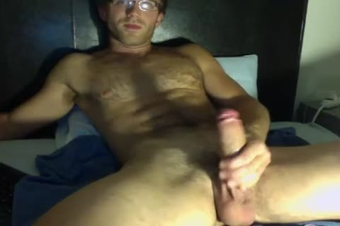 lusty lad In Glasses Jerks His large penis