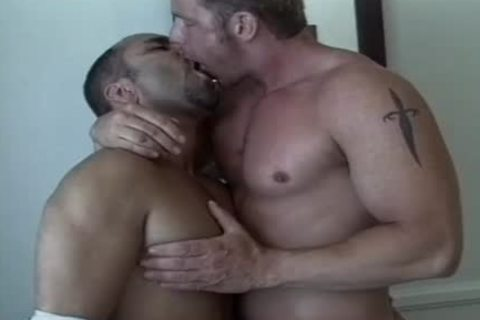 Tanned fellows enjoy An Intimate pont of time together
