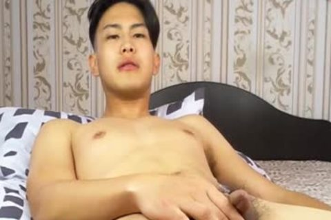 pretty Korean boy Tugging tiny penis And Shotting Loads Of sperm