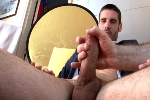 In Suits Straight Male receives Wanked His large knob Despite Of Him.